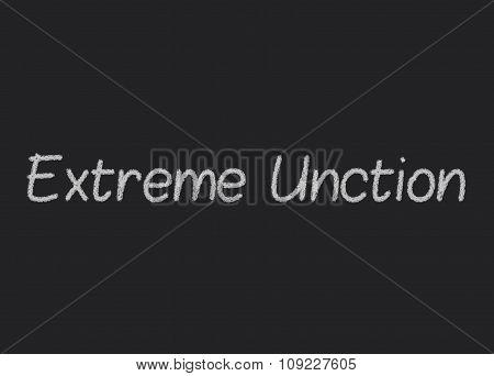 Extreme Unction written on a blackboard