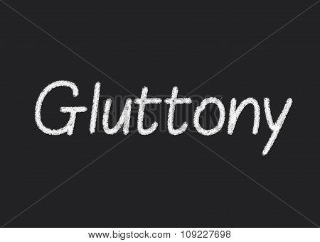 Gluttony written on a blackboard