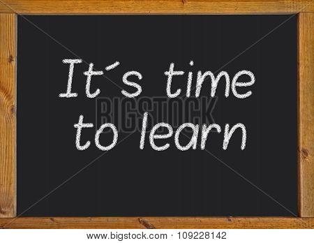 It´s time to learn written on a blackboard