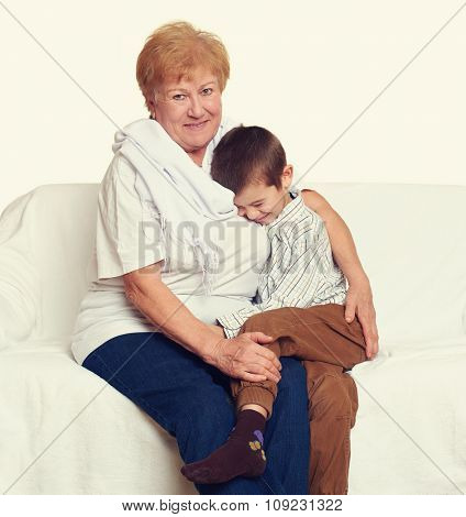 child boy and grandmother on white, happy family concept