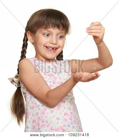 girl show lost tooth on a thread, studio portrait on white background