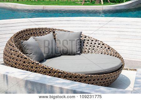 Relaxing Rattan Sofa At Swimming Pool