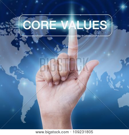 hand pressing core values word button.