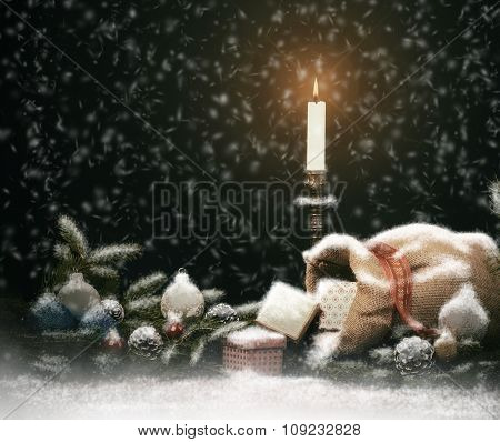 Christmas Composition. Gift Boxes, Candle, Balls and  Cones.