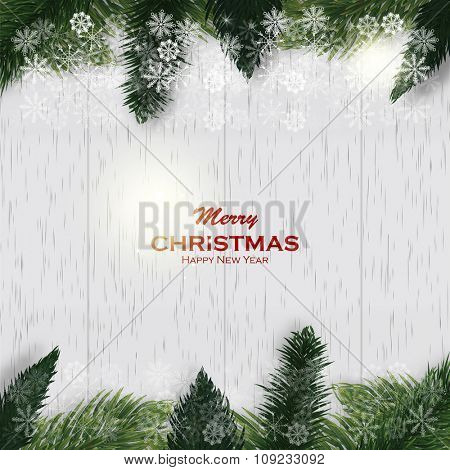 Christmas white wooden background with fir branches and snow. Christmas frame