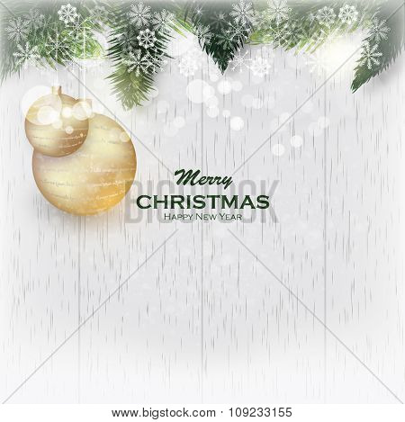 Christmas wooden background with fir branches. Christmas card with fir branches and golden balls. Christmas frame