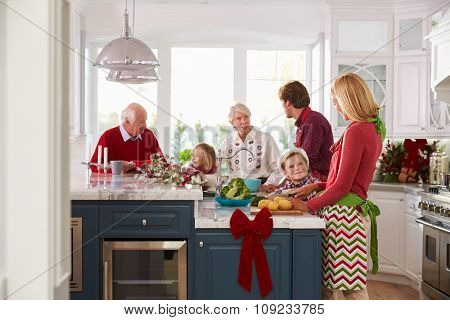 Family With Grandparents Preparing Christmas Meal In Kitchen