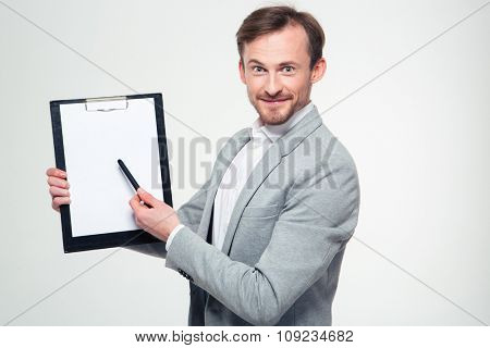 Portrait of a happy man showing blank clipboard isolated on a white background