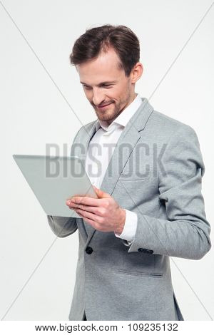 Portrait of a happy businessman using tablet computer isolated on a white background