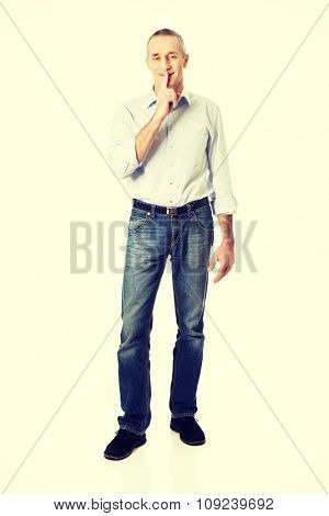 Mature man with silent gesture.