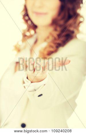 Businesswoman showing her empty hand.
