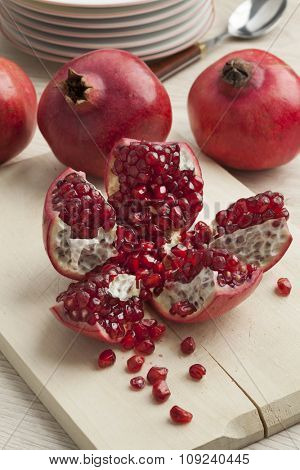 Open fresh red ripe pomegranate fruit and seeds