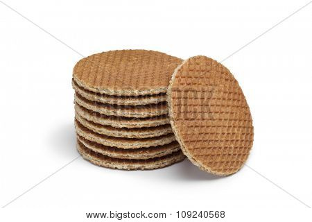 Heap of fresh baked Dutch syrup waffles on white background