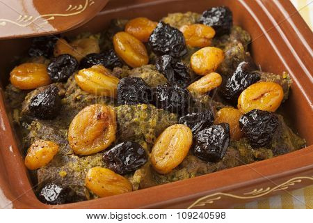 Square tagine with apricots and prunes close up