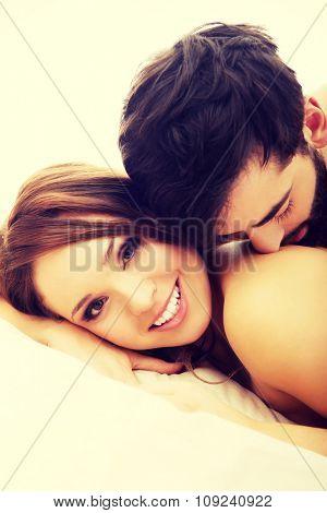 Young love couple in bed, romantic scene in bedroom.