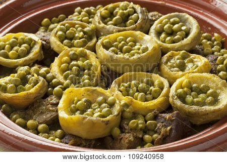 Traditional Moroccan tagine with meat, artichoke hearts and green peas