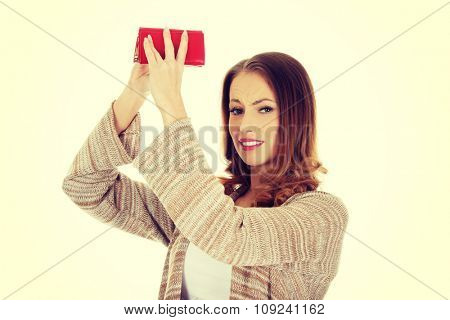 Unhappy bankrupt woman with empty wallet.