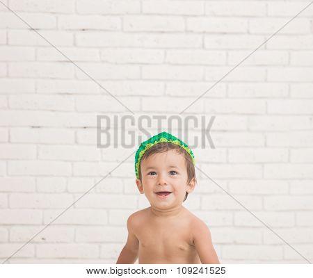 Cute Caucasian Boy Wearing A Green Knit Hat