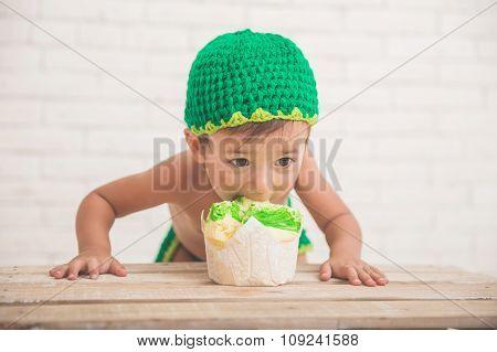 Caucasian Cute Boy Eating A Cake