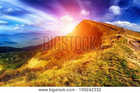 Majestic Sunset In The Mountains Landscape. Dramatic Sky. Carpat