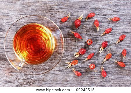 Herbal Tea From Rose Hips, Vitamin Drink, Hips, Based On White, View From Above On A Wooden Table.