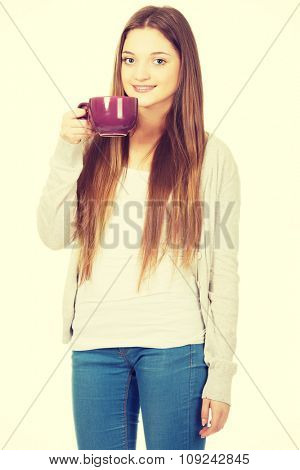Happy teen woman with a cup of tea.