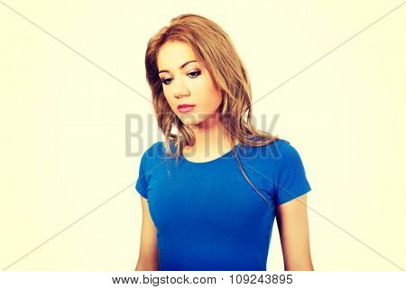 Beautiful unhappy woman looking down.