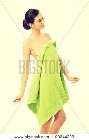 Smiling spa woman wrapped in towel.