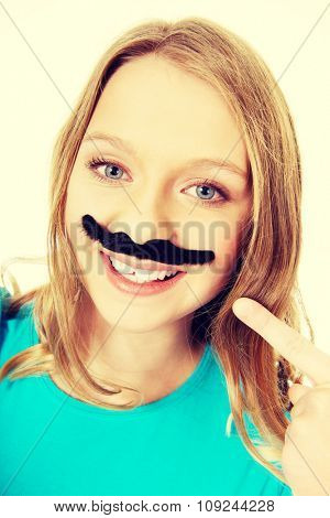 Happy teenage woman with a moustache