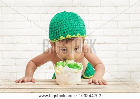 Cute Toddler Bite His Sponge Cake