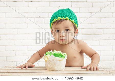 Adorable Toddler Eating Sponge Cake