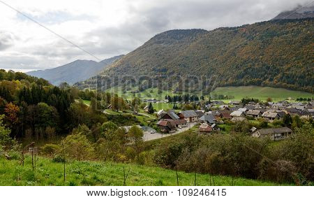 Small Mountain Village Under A Cloudy Sky