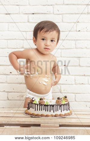 Cute Toddler Playing With His Creamy Cake