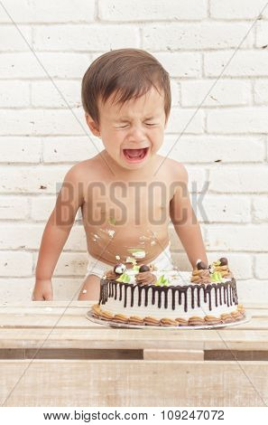 Cute Toddler Crying While Playing Smash Cake