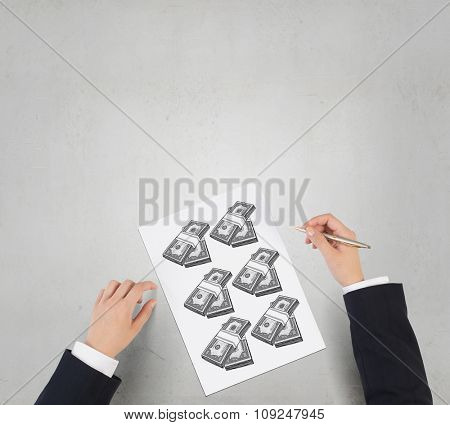 Businessman hands drawing money making formula in notepad