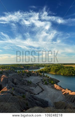 View from the top of the hill on lake landscape with beautiful reflection of a sky