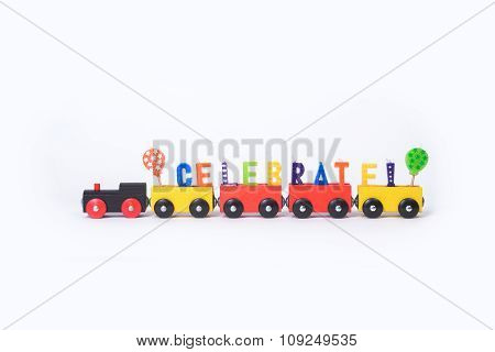 Toy Train With Colorful Letters On Top Arranged In Word Celebrate
