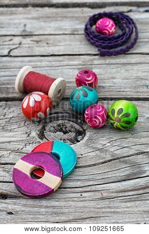 Beads On Wooden Background