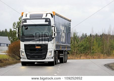White Volvo Fh Semi On The Road