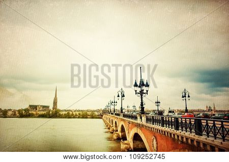 Old stony bridge in Bordeaux, France Europe