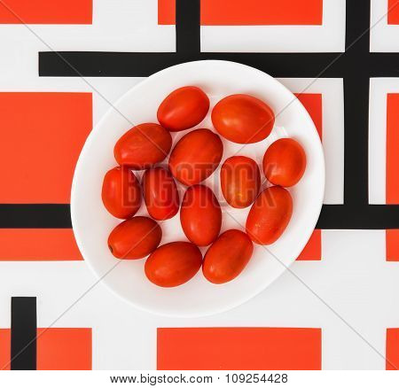 Cherry Tomatoes On White Plate And Red Geometric Modern Background