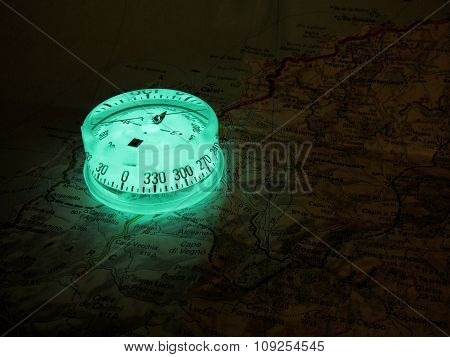 Glowing Compass On A Map