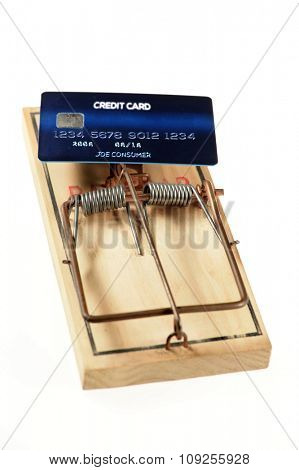 Credit card as bate on mousetrap isolated over white background