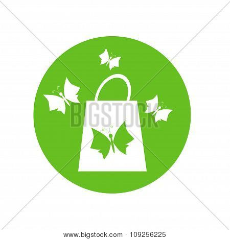 Shopping Bag And Butterflies On The Green Background