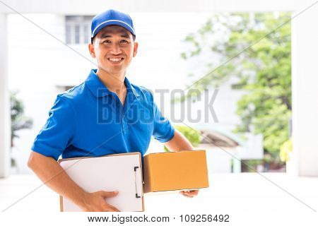 Delivery Man Holding A Parcel Box