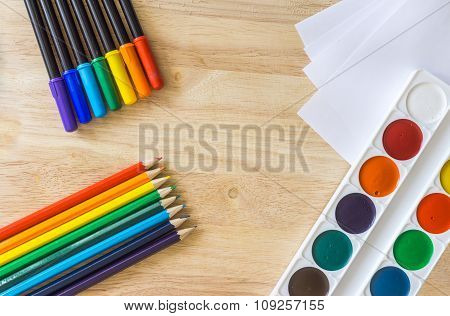 Colored Felt-tip Pens, Lying Like Rainbow Colored Pencils, White Paper And Watercolor On Wooden Back