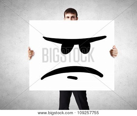 Businessman hold white board with sad face emoticon