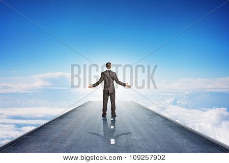 Businessman on road in sky