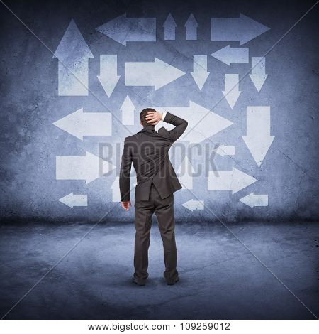 Businessman in front of different ways
