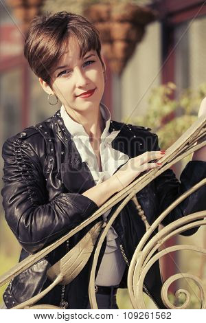 Happy young fashion woman in leather jacket